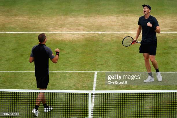 Jamie Murray of Great Britain and partner Bruno Soares of Brazil celebrate victory following the mens doubles final against Julien Benneteau of...