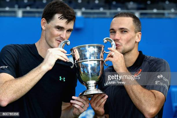 Jamie Murray of Great Britain and partner Bruno Soares of Brazil celebrate victory with the trophy following the mens doubles final against Julien...