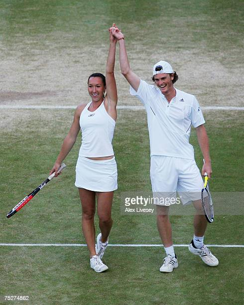 Jamie Murray of Great Britain and partner Jelena Jankovic of Serbia celebrate victory following the Mixed Doubles final match against Jonas Bjorkman...
