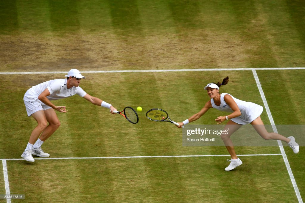 Jamie Murray of Great Britain and partner Martina Hingis of Switzerland in action during the Mixed Doubles final match against Heather Watson of Great Britain and Henri Kontinen of Finland on day thirteen of the Wimbledon Lawn Tennis Championships at the All England Lawn Tennis and Croquet Club at Wimbledon on July 16, 2017 in London, England.