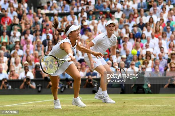 Jamie Murray of Great Britain and partner Martina Hingis of Switzerland in action during the Mixed Doubles final match against Heather Watson of...