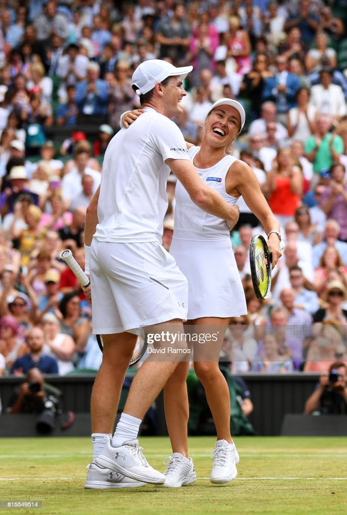 Jamie Murray of Great Britain and partner Martina Hingis of Switzerland celebrate championship point and victory during the Mixed Doubles final match against Heather Watson of Great Britain and Henri Kontinen of Finland on day thirteen of the Wimbledon Lawn Tennis Championships at the All England Lawn Tennis and Croquet Club at Wimbledon on July 16, 2017 in London, England.