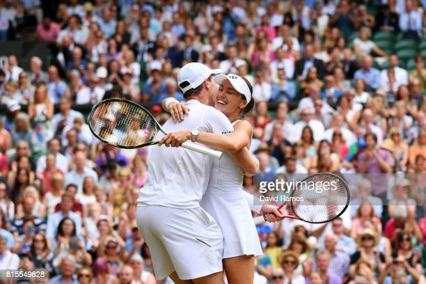Jamie Murray of Great Britain and partner Martina Hingis of Switzerland celebrate championship point and victory during the Mixed Doubles final match...
