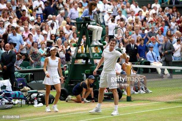 Jamie Murray of Great Britain and partner Martina Hingis of Switzerland celebrate victory after the Mixed Doubles final match against Heather Watson...
