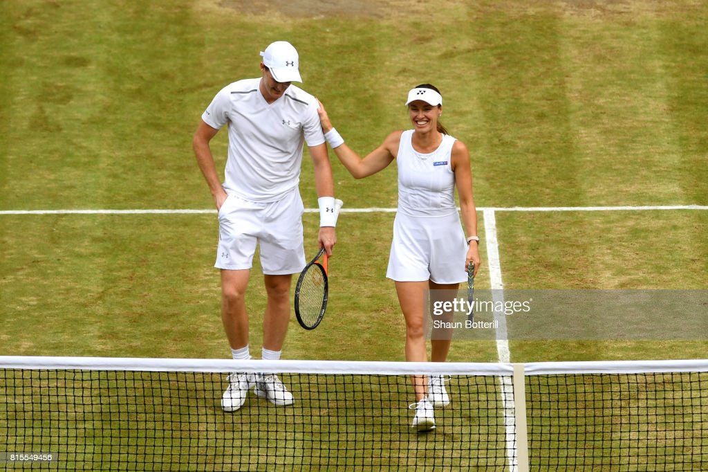 Jamie Murray of Great Britain and partner Martina Hingis of Switzerland celebrate victory after the Mixed Doubles final match against Heather Watson of Great Britain and Henri Kontinen of Finland on day thirteen of the Wimbledon Lawn Tennis Championships at the All England Lawn Tennis and Croquet Club at Wimbledon on July 16, 2017 in London, England.