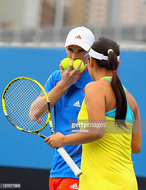 Jamie Murray of Great Britain and Shuai Peng of China talk tactics in their first round mixed doubles match against Abigail Spears of the United...