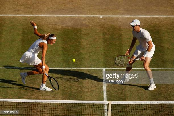 Jamie Murray of Great Britain and Victoria Azarenka of Belarus return against Alexander Peya of Austria and Nicole Melichar of The United States...