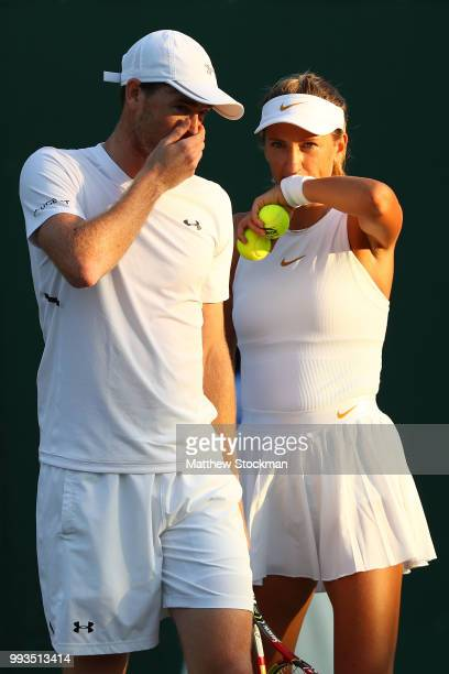 Jamie Murray of Great Britain and Victoria Azarenka of Belarus talk during their Mixed Doubles first round match against Roman Jebavy and Lucie...
