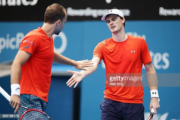 Jamie Murray of Great Britain celebrates with Bruno Soares of Brazil after winning a point in the Mens Doubles Final against Rohan Bopanna of India...