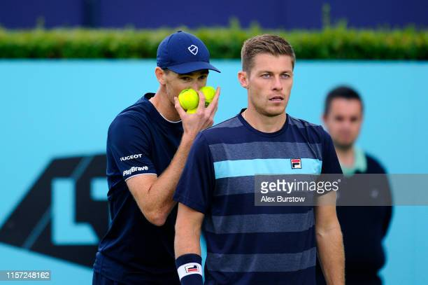 Jamie Murray of Great Britain gives instructions to playing partner Neal Skupski of Great Britain during their First Round Doubles Match against...
