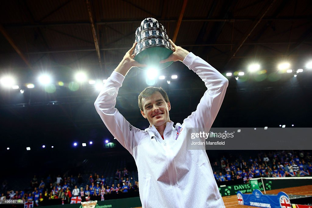 Jamie Murray of Great Britain lifts his trophy following their victory during day three of the Davis Cup Final match between Belgium and Great Britain at Flanders Expo on November 29, 2015 in Ghent, Belgium.