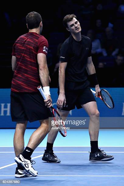Jamie Murray of Great Britain looks at Bruno Soares of Brazil after losing a point during their men's doubles semi final against Rajeev Ram of the...
