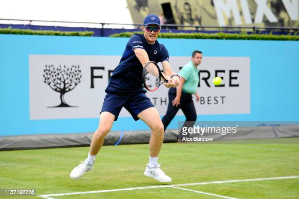 Jamie Murray of Great Britain partner of Neal Skupski of Great Britain plays a backhand during his First Round Doubles Match against Nicolas Mahut...