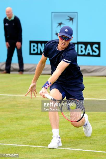 Jamie Murray of Great Britain partner of Neal Skupski of Great Britain plays a forehand at the net during his First Round Doubles Match against...