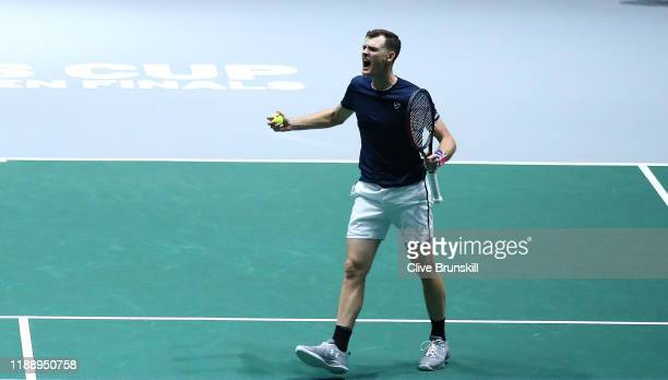 Jamie Murray of Great Britain, playing partner of Neal Skupski celebrates match point during their Davis Cup Group Stage match against Wesley Koolhof...