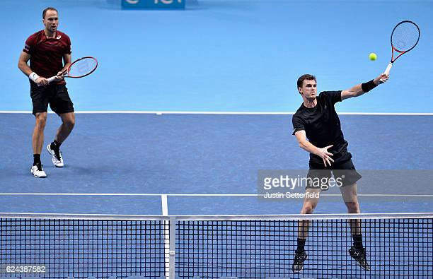Jamie Murray of Great Britain plays a forehand shot next to Bruno Soares of Brazil during their men's doubles semi final against Rajeev Ram of the...