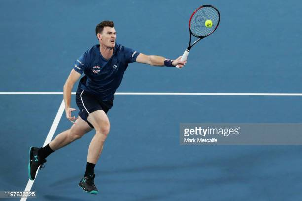 Jamie Murray of Great Britain plays a forehand volley whilst partnering Joe Salisbury of Great Britain during their Group C doubles match against...