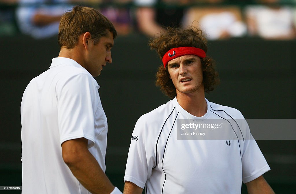 Jamie Murray of Great Britain (R) plays with Max Mirnyi of Belarus during the men's doubles round two match against James Cerretani of United States and Victor Hanescu of Romania v on day six of the Wimbledon Lawn Tennis Championships at the All England Lawn Tennis and Croquet Club on June 28, 2008 in London, England.