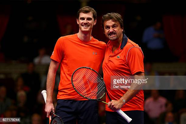 Jamie Murray of Great Britain poses with his partner Henri Leconte of France during their doubles match against Mansour Bahrami of Iran and John...