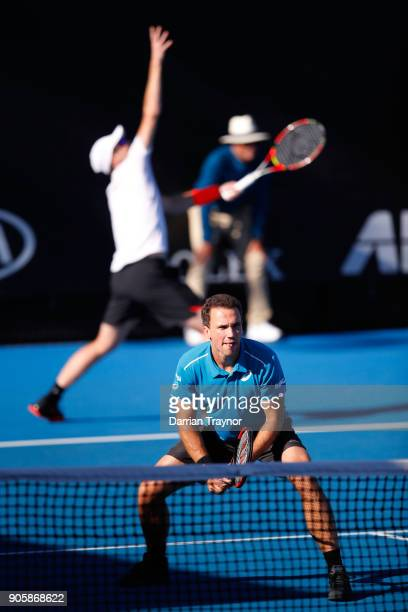 Jamie Murray of Great Britain serves in his first round men's doubles match with Bruno Soares of Brazil against Frances Tiafoe of the United States...