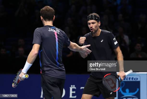 Jamie Murray of Great Britain shakes hands with Bruno Soares of South Africa during their match against Raven Klaasen of South Africa and Michael...