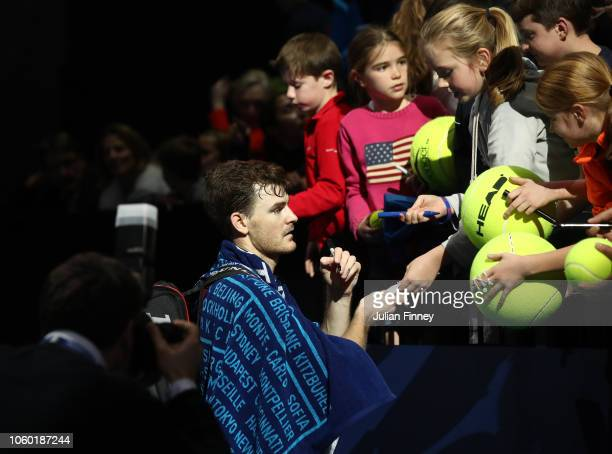Jamie Murray of Great Britain signs balls for the crowds after his doubles match during Day One of the Nitto ATP Finals at The O2 Arena on November...