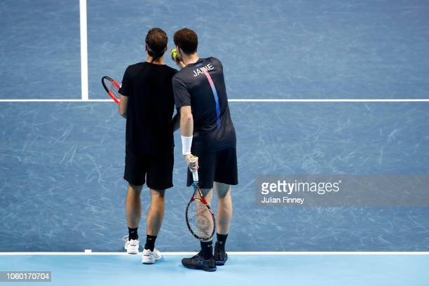 Jamie Murray of Great Britain speaks to Bruno Soares of South Africa during their match against Raven Klaasen of South Africa and Michael Venus of...