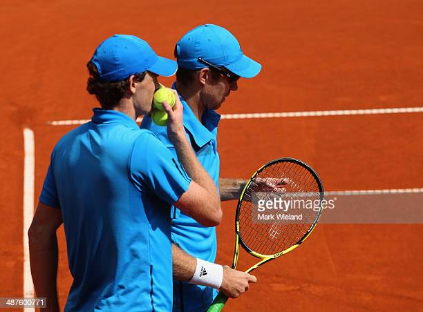 Jamie Murray of Great Britain talks tatics with John Peers of Australia during their match against Lukas Dlouhy of the Czech Republic and Mate Pavic...