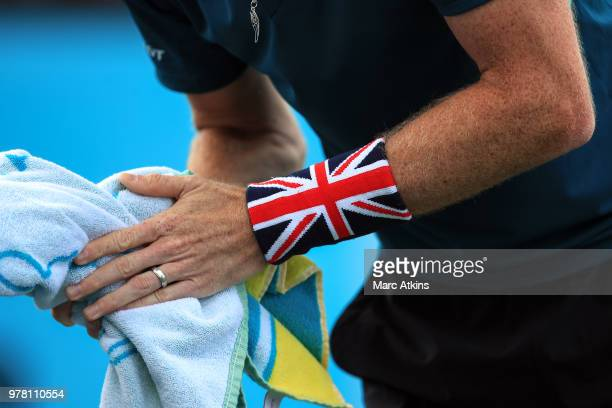 Jamie Murray of Great Britain wearing a sweat band in the colours of the Union flag during Day 1 of the FeverTree Championships at Queens Club on...