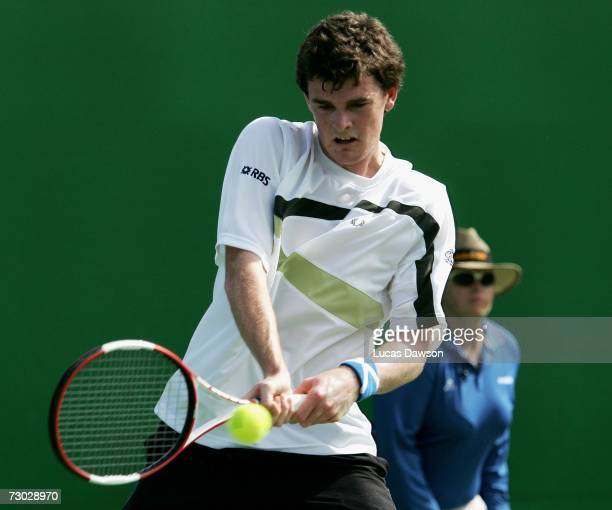 Jamie Murray of Great Britian plays a backhand during his first round doubles match with Benjamin Becker of Germany against Julien Benneteau and...