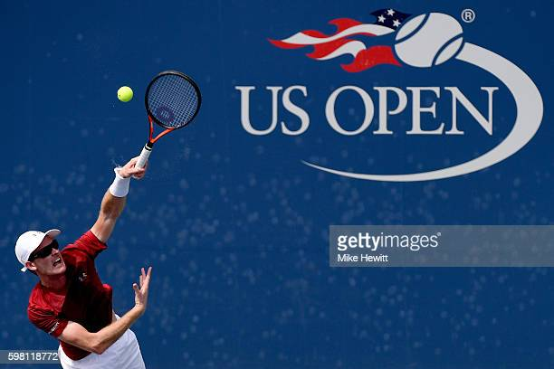 Jamie Murray of the United Kingdom serves to Gastao Elias of Portugal and Joao Sousa of Portugal during the first round Men's Doubles match on Day...