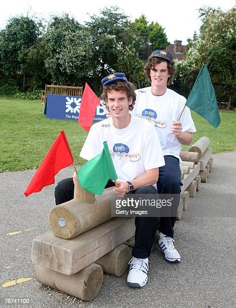 Jamie Murray sits behind his brother Britains no 1 tennis player and Ambassador Andy Murray during the RBS Supergrounds Schools Investment Photocall...
