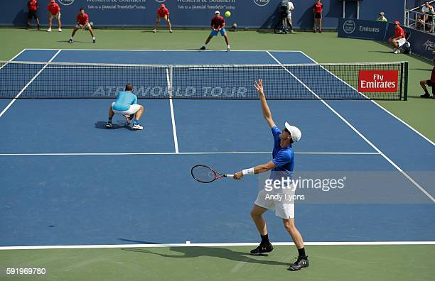 Jamie Murray tosses the ball on his serve along with his partner Bruno Soares in their match and against JeanJulien Rojer and Horia Tecau during day...