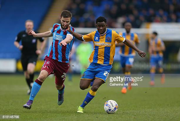 Jamie Ness of Scunthorpe United and Larnell Cole of Shrewsbury Town during the Sky Bet League One match between Shrewsbury Town and Scunthorpe United...