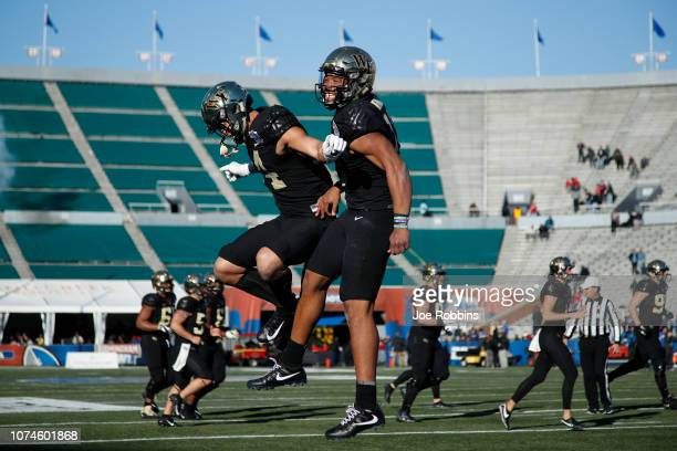 Jamie Newman of the Wake Forest Demon Deacons celebrates with Sage Surratt after scoring the winning touchdown against the Memphis Tigers in the...