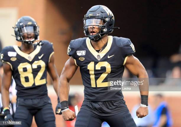 Jamie Newman of the Wake Forest Demon Deacons reacts after scoring a touchdown against the North Carolina Tar Heels during their game at BBT Field on...