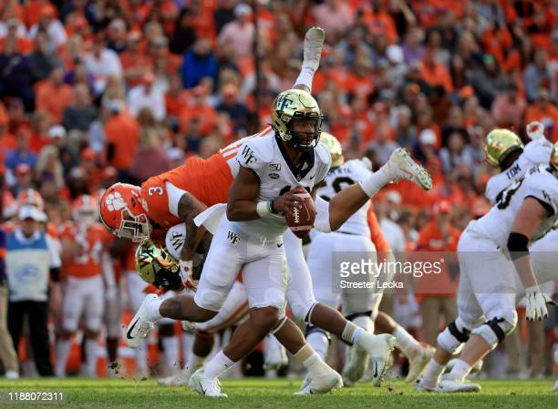 Jamie Newman of the Wake Forest Demon Deacons runs with the ball against the Clemson Tigers during their game at Memorial Stadium on November 16,...