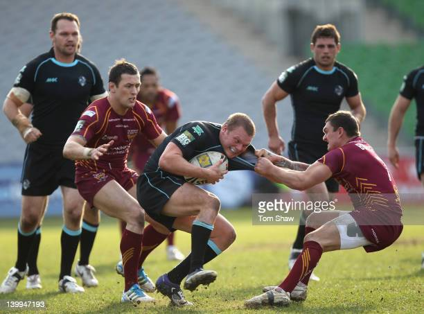 Jamie O'Callaghan of Broncos is tackled during the Super League match between London Broncos and Huddersfield Giants at Twickenham Stoop on February...