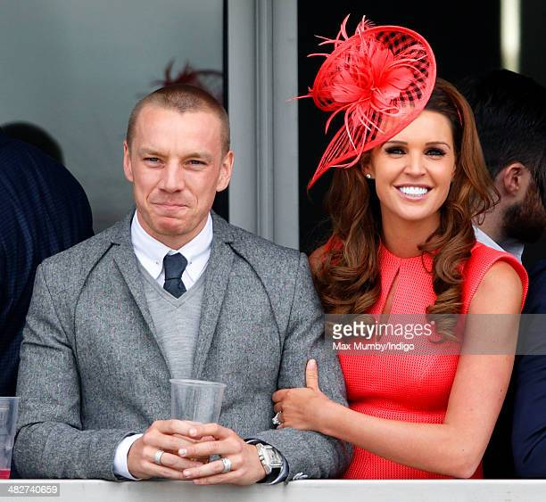 Jamie O'Hara and Danielle O'Hara watch the racing as they attend day 2 Ladies Day of the Crabbie's Grand National horse racing meet at Aintree...
