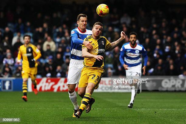 Jamie O'Hara of Fulham holds off Daniel Tozser of Queens Park Rangers during the Sky Bet Championship match between Queens Park Rangers and Fulham at...