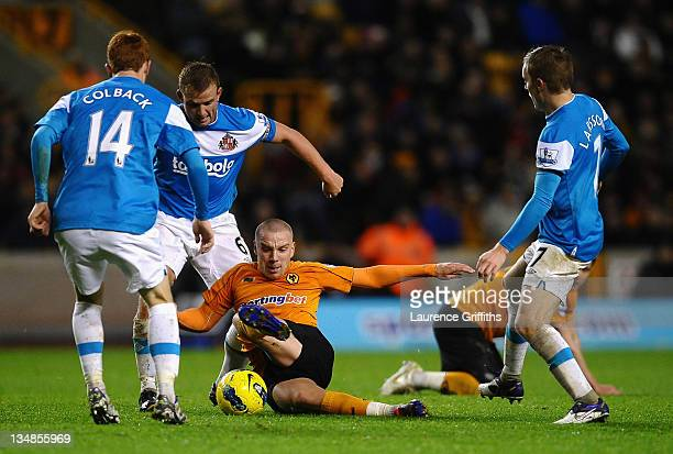 Jamie O'Hara of Wolverhampton Wanderers battles with Lee Cattermole and Sebastian Larsson of Sunderland during the Barclays Premier League match...