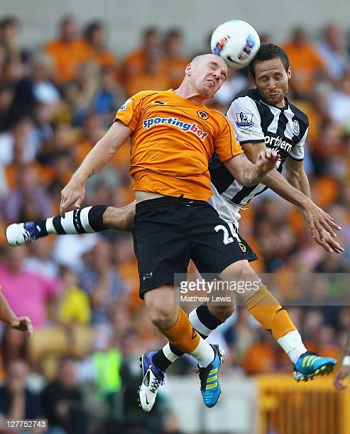 Jamie O'Hara of Wolves and Yohan Cabaye of Newcastle challenge for the ball during the Barclays Premier League match between Wolverhampton Wanderers...