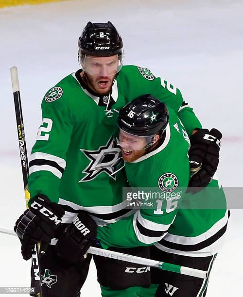 Jamie Oleksiak of the Dallas Stars celebrates his game winning goal at 1920 of the third period against the Calgary Flames and is joined by Joe...