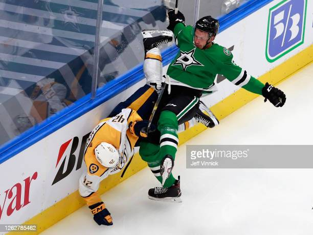 Jamie Oleksiak of the Dallas Stars checks Colin Blackwell of the Nashville Predators during the second period in an exhibition game prior to the 2020...