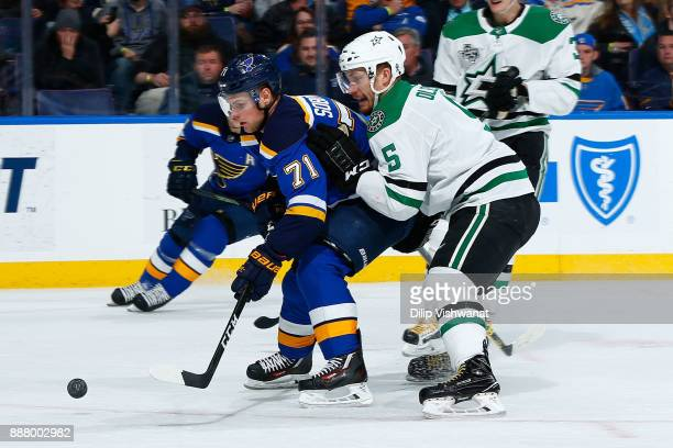 Jamie Oleksiak of the Dallas Stars defends against Vladimir Sobotka of the St Louis Blues at Scottrade Center on December 7 2017 in St Louis Missouri