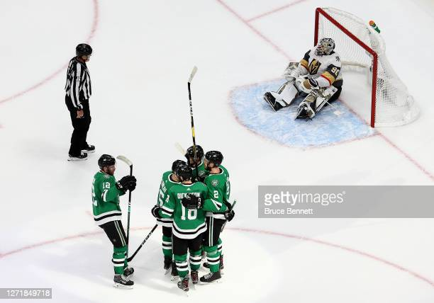 Jamie Oleksiak of the Dallas Stars is congratulated by his teammates after scoring a goal past Robin Lehner of the Vegas Golden Knights during the...