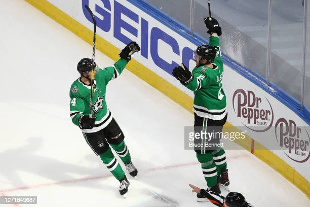 Jamie Oleksiak of the Dallas Stars is congratulated by Miro Heiskanen after scoring a goal against the Vegas Golden Knights during the second period...