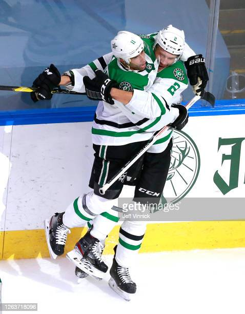 Jamie Oleksiak of the Dallas Stars is congratulated by teammate Andrew Cogliano after he scored in the second period against the Vegas Golden Knights...