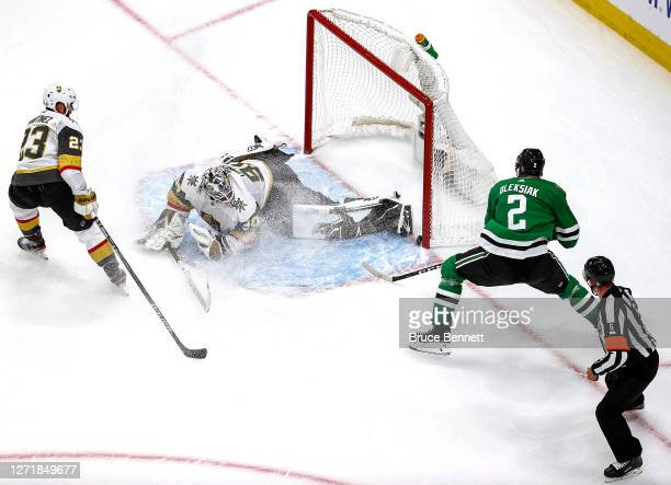 Jamie Oleksiak of the Dallas Stars scores a goal past Robin Lehner of the Vegas Golden Knights during the second period in Game Three of the Western...