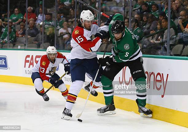 Jamie Oleksiak of the Dallas Stars skates the puck against Drew Shore of the Florida Panthers in the second period during a preseason game at...